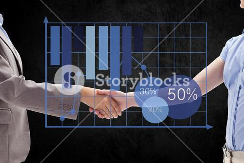 Digital composite image of business partners shaking hands by graph
