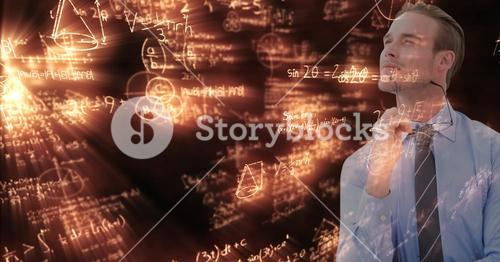 Digital composite image of businessman with math equations