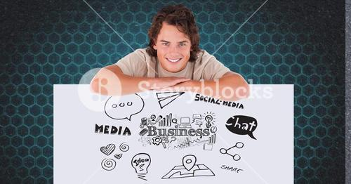 Smiling man leaning on bill board with business and media icons