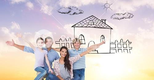 Portrait of happy family with dream house