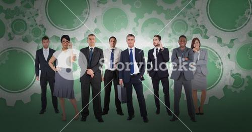 Digital composite image of business people with gear background