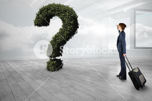 Businesswoman with bag looking at question mark made of plants