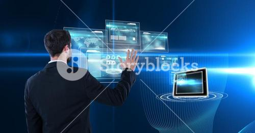 Digitally generated image of businessman touching futuristic screen