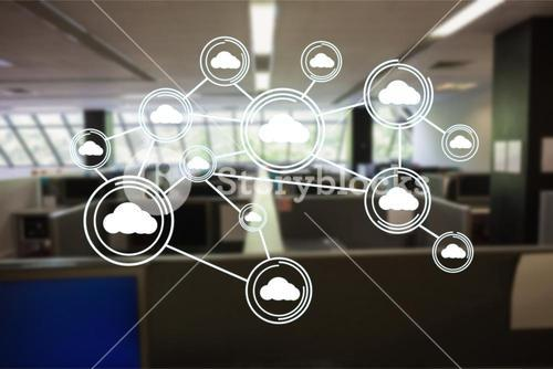 Digitally generated image of cloud computing icons in office