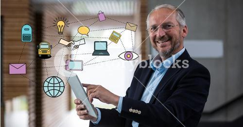 Digitally generated image of various icons with businessman using digital tablet in office