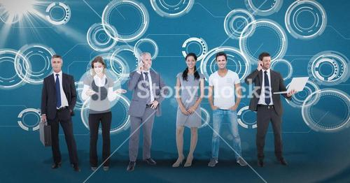 Digitally generated image of business people standing against tech graphics