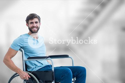 Portrait of man sitting on wheelchair in hospital