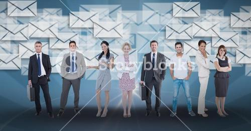 Digitally generated image of business people standing against envelope icons in background