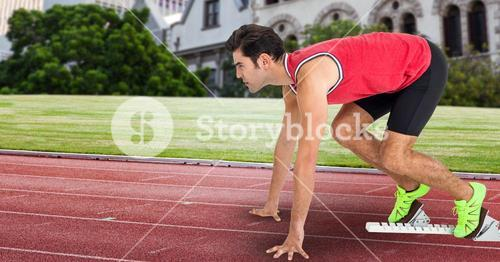 Side view of man at starting point on racing track