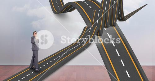 Digitally generated image of  businessman on wavy road in sky
