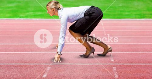Digitally generated image of Businesswoman on starting point at racing track