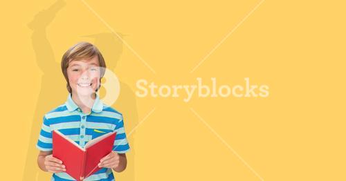 Digitally generated image of smiling boy holding book with shadow of graduate student in yellow back