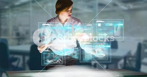 Digitally generated image of businesswoman touching futuristic screen in office