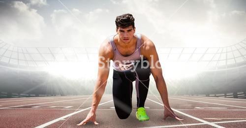 Digitally generated image of male athlete at starting point on racing track