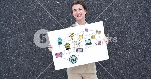 Smiling businesswoman holding billboard with various icons against gray background