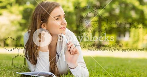 Digitally generated image of various structure with woman studying on field in background