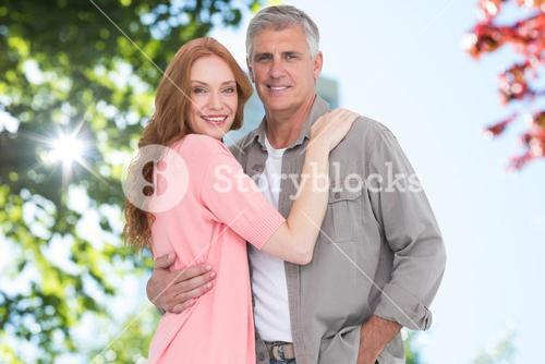 Portrait of senior couple standing against sky