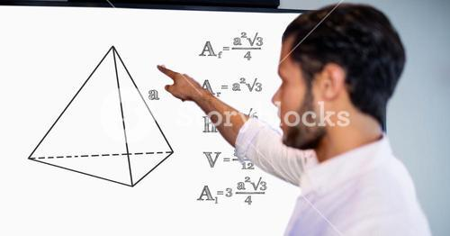 Man pointing over geometric shape by formulas on board