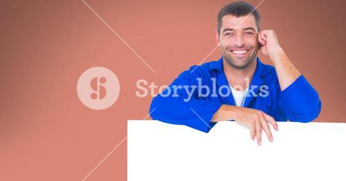 Portrait of worker leaning on blank bill board