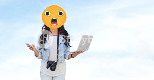 Woman with angry emoji holding laptop