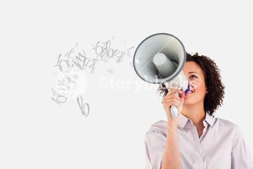 Young businesswoman talking in megaphone