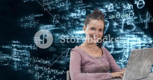 Digital composite image of woman using laptop with math equations in background