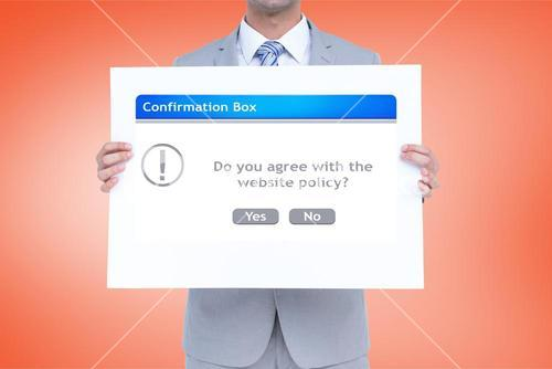 Digital composite image of businessman holding confirmation box