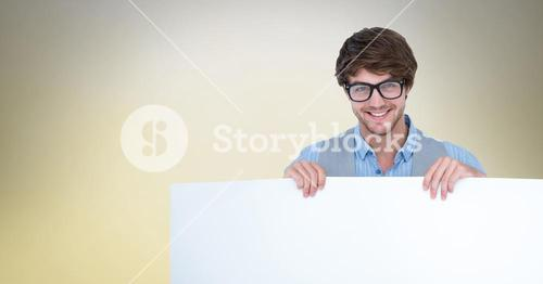Man wearing eyeglasses while holding blank bill board