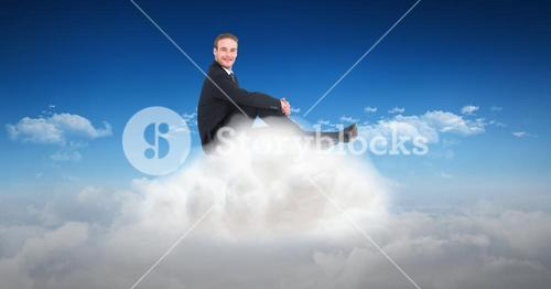 Digital composite image of businessman sitting on clouds