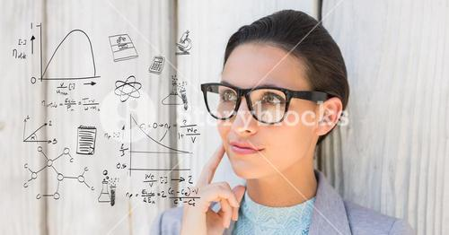 Thoughtful woman looking at math equations