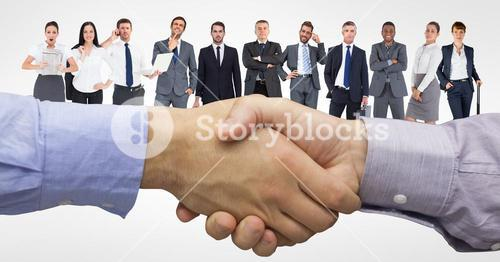 Digital composite image of handshake with business people in background