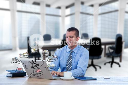 Digital composite image of businessman using laptop with web design icons in foreground