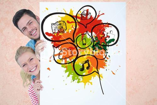 Digital composite image of couple holding bill board with chat bubbles and technologies drawn on it