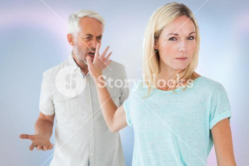 Mature woman showing stop gesture to man arguing