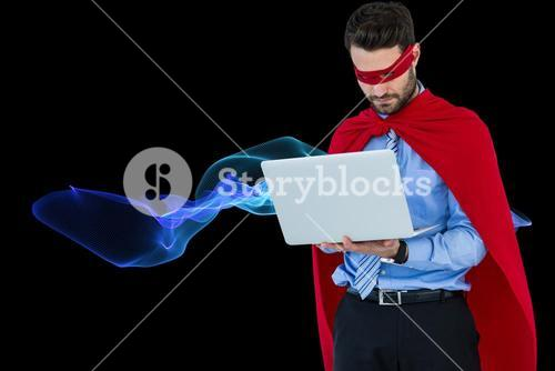 Digital composite image of businessman in super hero using laptop