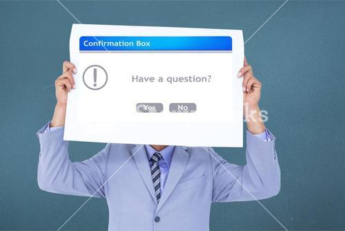 Business executive holding confirmation box sign over face