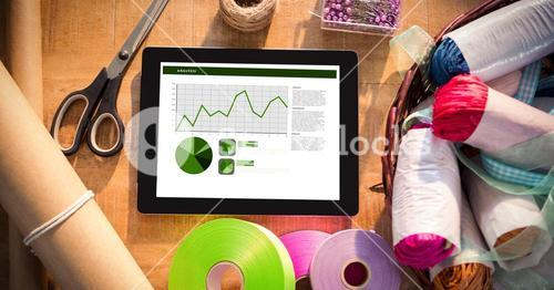 Digital tablet with graphs by art and craft equipment