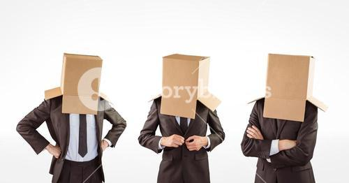 Multiple image of businessmen with cardboard boxes covering head