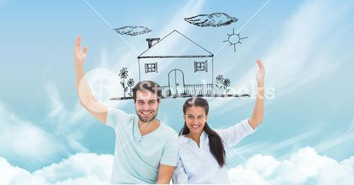 Happy couple with dream house in sky