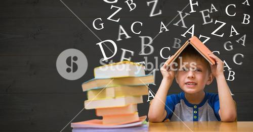 Boy with book on head against letters flying in background