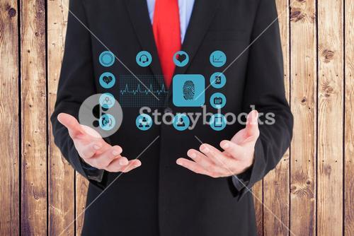Midsection of businessman with medical icons