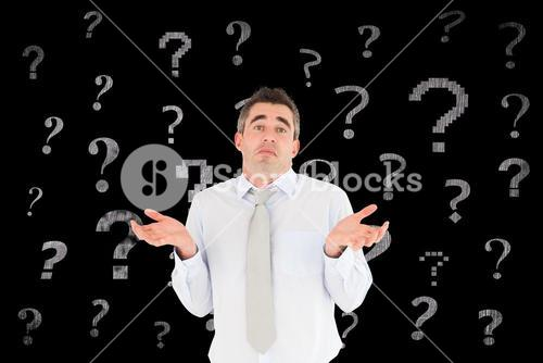 Confused businessman with question mark signs