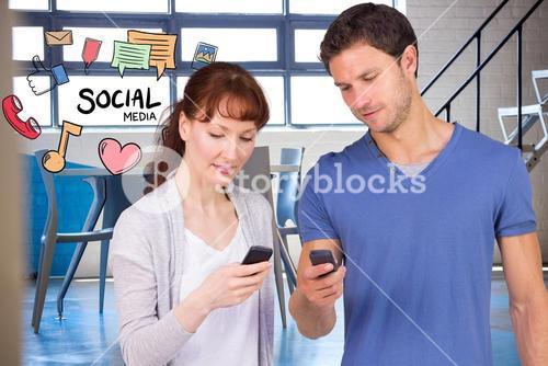 Man and woman using social media on smart phones
