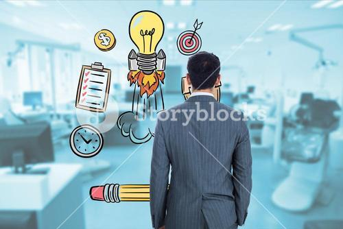 Rear view of businessman looking at icons