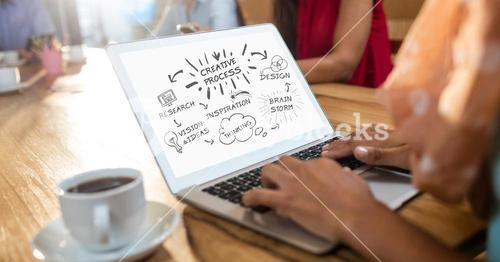 Cropped image of business woman making creative process diagram at table