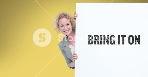 Portrait of businesswoman behind bill board with bring it on sign