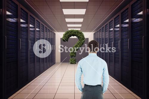 Rear view of businessman looking at question mark