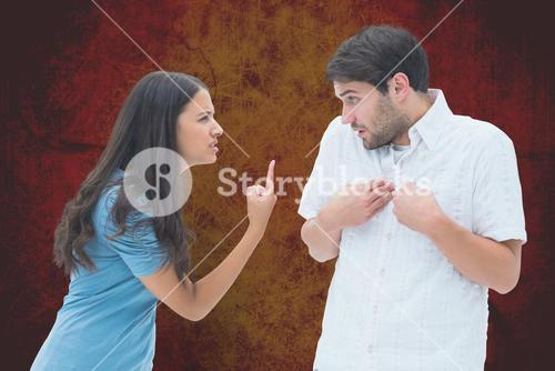 Angry couple arguing over orange background