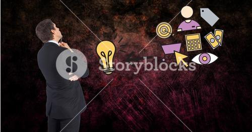 Businessman with light bulb and icons
