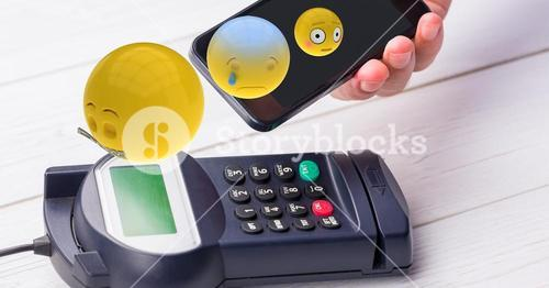 Emojis flying over mobile phone during NFC payment